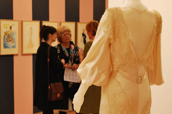 Guests discuss the Dreaming of Chanel exhibition at the QUT Art Museum