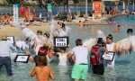 "Activists ""The Climate Guardians"" take a dip to protest against climate change inaction"