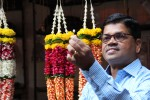 Victor, our savvy tour guide, admires the flower garland at the Dadar Flower Markets.