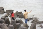 Two teenagers take a seaside selfie on the jagged rocks at Colaba.