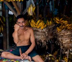 A local Indonesian man selling bananas in the markets