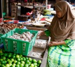 A local woman peeling garlic