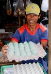 A local man selling green coloured chicken eggs