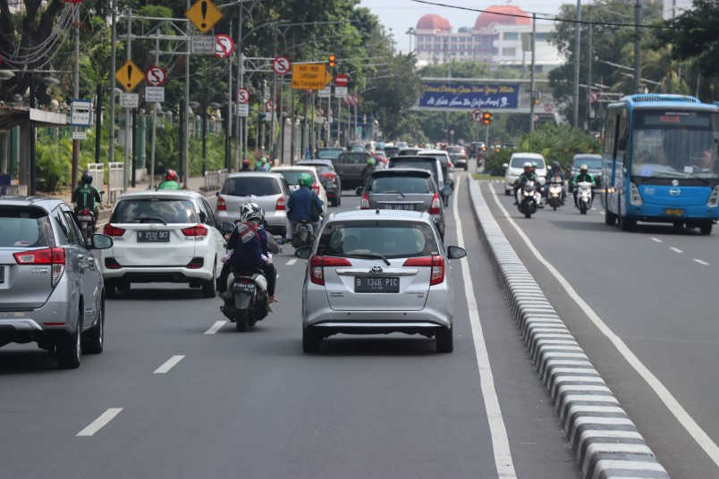 Some of the many cars and bikes in Jakarta's city centre, as well as one of the city's new busses