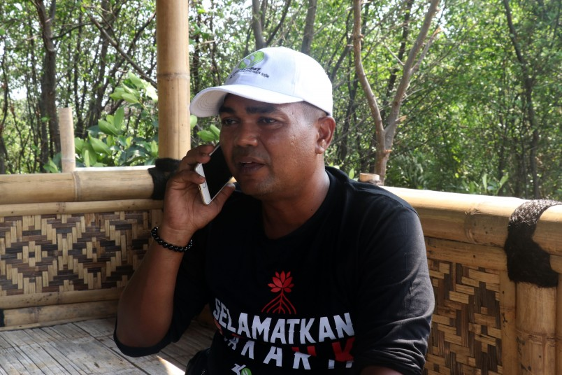 Isnandar, local to Muara Angke and founder of a local mangrove protection group