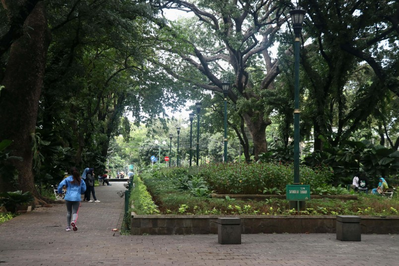 Taman Suopati, the park is often used for exercise by locals